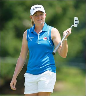 Toledo-born Stacy Lewis' 7-under par in the final round catapulted her into a tie for seventh place.