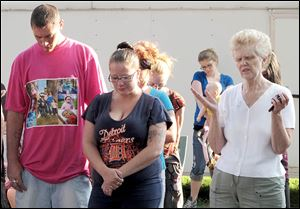 TJ Steinfurth and his girlfriend, Becky Navaugh, pray during the vigil for his missing daughter, Elaina.