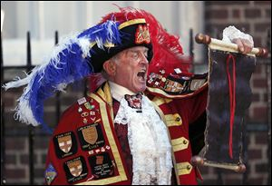 Tony Appleton, a town crier, announces the birth of the as-yet publicly unnamed baby outside St. Mary's Hospital's exclusive Lindo Wing in London.