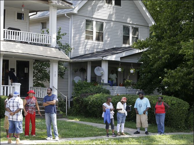Ohio Bodies crime scene East Cleveland residents watch the scene, Sunday, close to where three bodies were recently found.