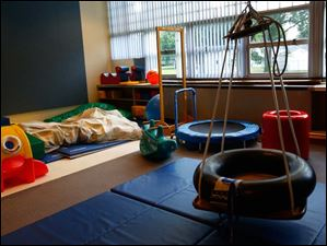 The sensory motor playroom at the EduCare Center in South Toledo sports a number of games and toys designed to aid in therapy and development for impaired children.