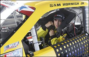 Sam Hornish, Jr., tests his Alliance Truck Parts/​WURTH Ford Mustang on the half-mile Toledo Speedway oval in preparation for short-track races on the Nationwide series.