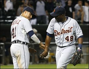 Detroit Tigers' Victor Martinez (41) celebrates with right fielder Torii Hunter the Tigers' 7-3 win over the Chicago White Sox.