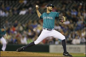 Seattle Mariners closer Tom Wilhelmsen throws in the ninth inning.