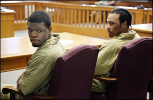 Gang members Antwaine Jones, 19, left, and Keshawn Jennings, 21, are sentenced in Lucas County Common Pleas Court for the shooting death of toddler Keondra Hooks at Moody Manor.
