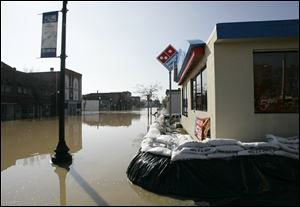 Sandbags prevent flood water from the Blanchard River from entering a Domino's Pizza on North Main Street in Findlay in 2011.