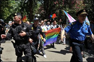 Montenegro gay activists march down a street during the first ever pride event in the Montenegrin seaside resort of Budva today.