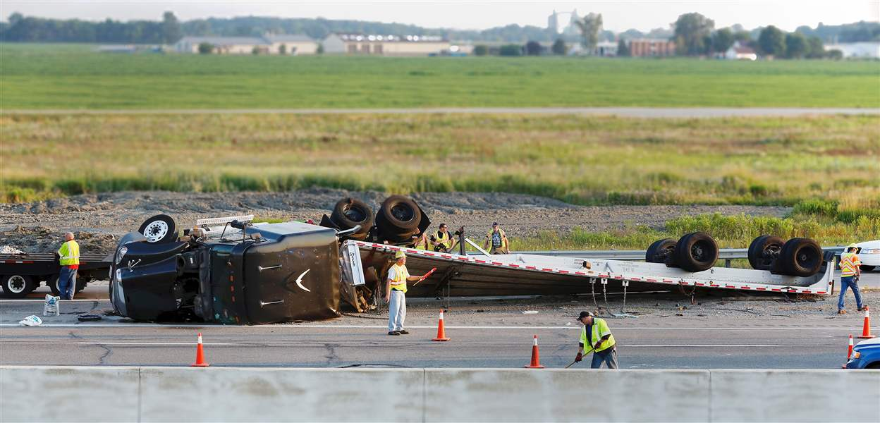 Crews-work-on-an-overturned-semi-truck-on-the-I