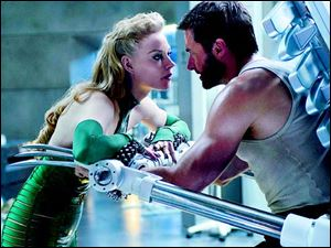 Svetlana Khodchenkova as Viper, left, and Hugh Jackman in a scene from 'The Wolverine.'