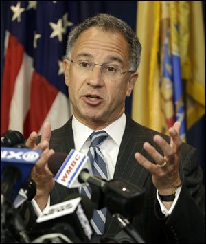 U.S. Attorney Paul Fishman says the group is connected with stealing and selling at least 160 million credit and debit card numbers, resulting in losses of hundreds of millions of dollars. Princeton-based Heartland Payment Systems Inc., which processes credit and debit cards for small to mid-sized businesses, was identified as taking the biggest hit in a scheme starting in 2007.