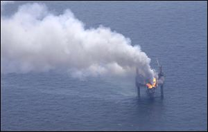 A fire is seen on the Hercules 265 drilling rig in the Gulf of Mexico off the coast of Louisiana.
