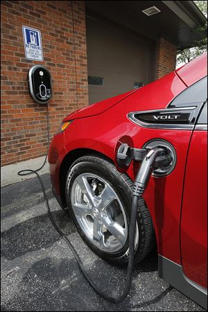 A Chevrolet Volt electric automobile is charged in Perrysburg.