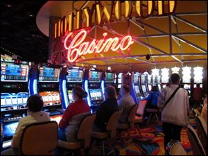 Gamblers play the slot machines in the Hollywood Casino Columbus.