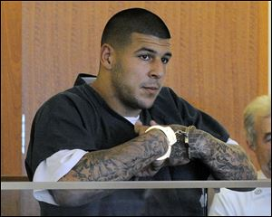 Aaron Hernandez stands during a bail hearing in Fall River Superior Court last month in Fall River, Mass.