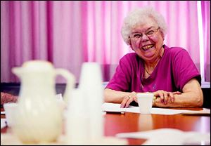 Oregon resident Bonnie Lutzmann joins in the laughter while talking about the church's history.