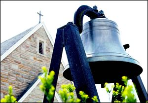 The bell outside First St. Mark's Lutheran Church.