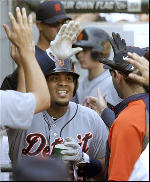 Detroit Tigers' Brayan Pena celebrates in the dugout after hitting a home run off Chicago White Sox starting pitcher Jake Peavy during the eighth inning.