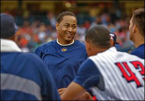 Jair Jurrjens jokes with teammates before Friday night's game against Buffalo at Fifth Third Field.