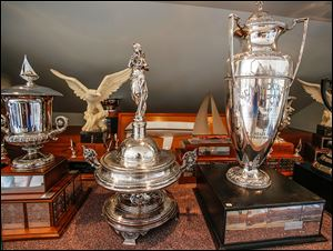 The Emery D. Potter trophy, center, is pictured in the trophy case at the Toledo Yacht Club.