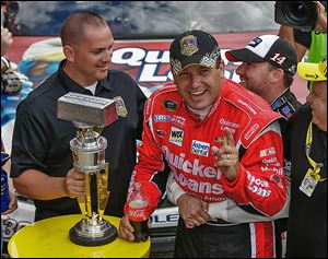 Sprint Cup Series driver Ryan Newman, right, is hugged by team owner and driver Tony Stewart after Newman won the Brickyard 400 at the Indianapolis Motor Speedway.