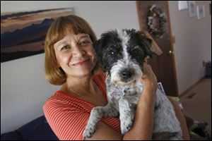 Linda Pittman and her eight-year-old Fell terrier Molly was diagnosed with leptospirosis, a bacterial infection that can cause flulike symptoms and affects the liver and kidneys. Ms. Pittman's other two dogs have not tested positive for the illness.