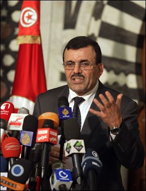 Tunisian Prime Minister Ali Larayedh addresses the media during a press conference