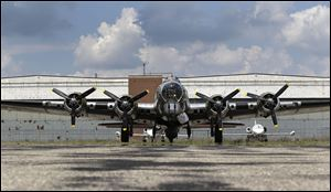 "The B-17G ""Yankee Lady"" is parked in front of the old Willow Run Bomber Plant at Willow Run Airport in Ypsilanti Township, Mich. Donors are hoping to save the plant and convert it into the new home of the Yankee Air Museum."