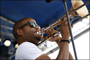Trombone Shorty performs at the 54th edition of the Newport Folk Festival in Newport, R.I.