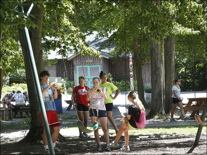n3camp Lexi Clark, 15, center, practices her trumpet during band camp at 4-H Camp Palmer near Fayette, Ohio. The camp has 41 buildings on 157 acres, and has served more than 295,000 campers since it opened in 1946. The camp is  privately owned by 4-H members in 11 northwest Ohio counties.