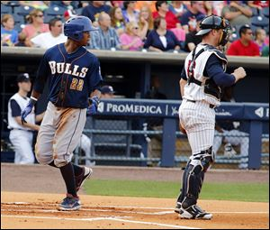 Durham's Tim Beckham scores behind Mud Hens catcher Bryan Holaday in the first inning Tuesday at Fifth Third Field.