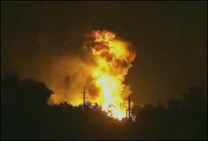 Flames rise from an explosion at the Blue Rhino propane plant in Tavares City, Fla., late Monday.
