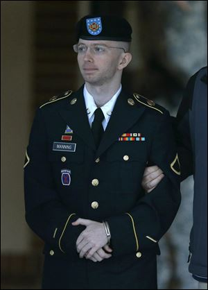 Army Pfc. Bradley Manning is escorted to a security vehicle outside of a courthouse in Fort Meade, Md., today after the third day of deliberations in his court martial.