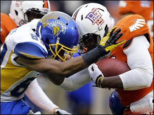 San Jose State's Chandler Jones tackles Bowling Green's Jerry Gates with a head-to-head collision in the Military Bowl. Helmet-to-helmet hits now are subject to a 15-yard penalty and ejection.