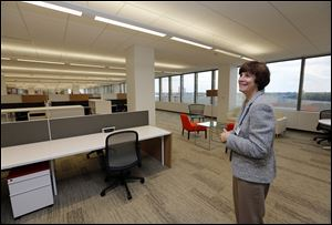 CEO Stephanie Streeter shows off Libbey's redesigned headquarters in the Toledo Edison Building during a tour on Wednesday. A wall of windows provides natural light, contributing to the open feel.