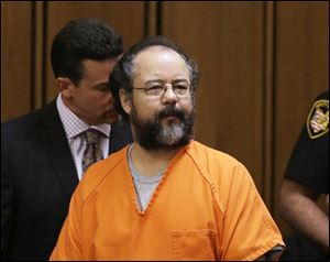 Ariel Castro enters the courtroom during the sentencing phase today in Cleveland.