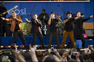 Members of the Backstreet Boys, from left to right, Nick Carter, Howie Dorough, A. J. McLean, Brian Littrell and Kevin Richardson perform on ABC's 'Good Morning America' in 2012 in New York.