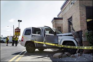 The inside of the Wendy's on West Laskey Road was damaged when Joseph Lisowski lost control of his Jeep and crashed through a brick wall. Two employees and Lisowski were injured.