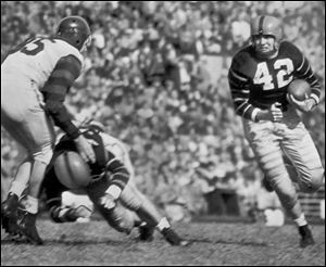 Dick Kazmaier carries the ball for Princeton in a 1951 game, the year the Maumee grad won the Heisman.