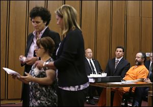 Michelle Knight, a victim, speaks during the sentencing phase for Ariel Castro, right,  today in Cleveland.