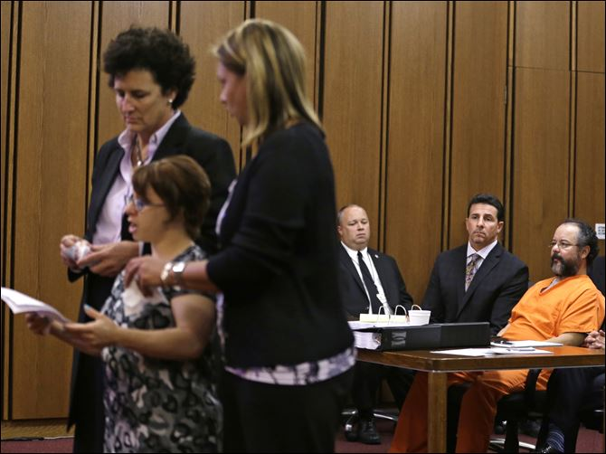 Missing Women Found KNIGHT, CASTRO Michelle Knight, a victim, speaks during the sentencing phase for Ariel Castro, right,  today in Cleveland.