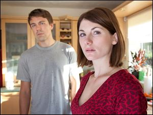 "This publicity image released by BBC America shows Jodie Whittaker as Beth Latimer, right, and Andrew Buchan as Mark Latimer from the series ""Broadchurch."""