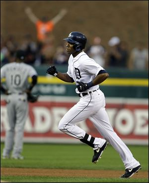 The Tigers' Austin Jackson rounds second base after his solo home r