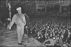 Comedian Bob Hope entertains sailors of the U.S. 6th Fleet Saratoga at the flagship's anchorage in the southern Italian port of Gaeta, in this Dec. 19, 1970 file photo. An exhibit called Bob Hope: An American Treasure will celebrate the beloved comedian at the National World War II Museum in New Orleans.