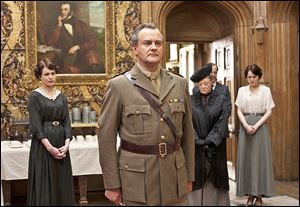 From left, Elizabeth McGovern, Hugh Bonneville, Maggie Smith, and Michelle Dockery are shown in a scene from the second season of 'Downton Abbey.'  The series has catapulted viewership of PBS.