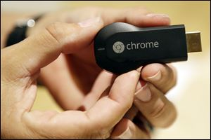 Google's new Chromecast, priced at only $35, adds the Internet to TVs at home via wireless networks.
