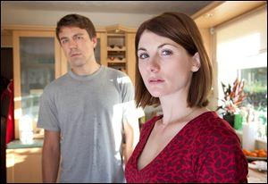 This publicity image released by BBC America shows Jodie Whittaker as Beth Latimer, right, and Andrew Buchan as Mark Latimer from the series
