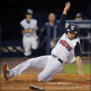 The Mud Hens' Ben Guez slides into home plate safely against the Durham Bulls during the sixth on Friday at Fifth Third Field.