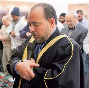Imam Farooq Abo Elzahab leads a prayer services at the Islamic Center of Greater Toledo.