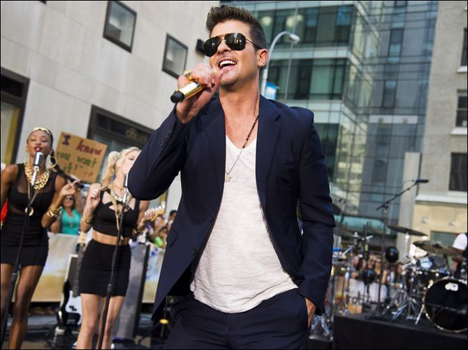 "At 36, though, show-business veteran Robin Thicke is well past his hotshot years, and ""Blurred Lines"" is far from his first crack at the charts."