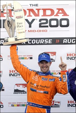 Charlie Kimball celebrates his first IndyCar win at the Honda Indy 200 at Mid-Ohio Sports Car Course in Lexington, Ohio.